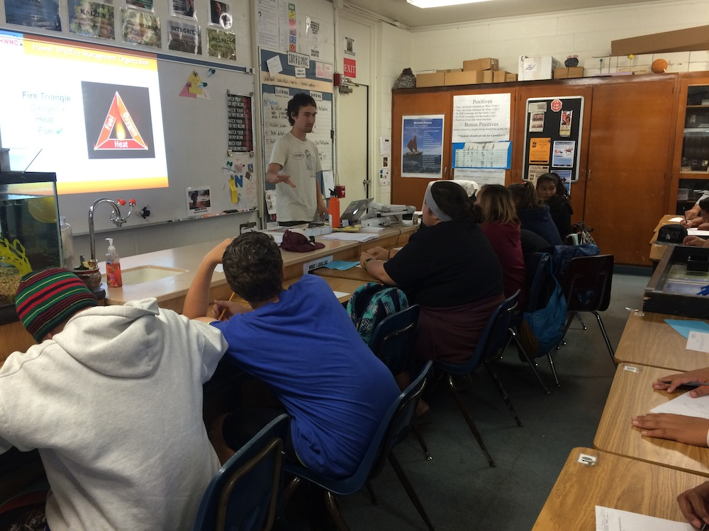 Pablo Beimler explains to Ms. Murphy's 8th graders the basics of the fire triangle: fuel, heat, and oxygen.