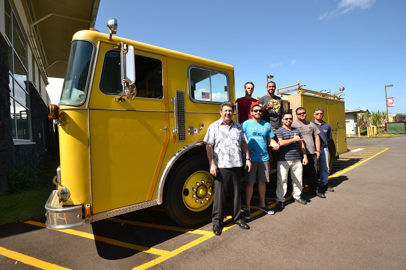 """Hawai'i Community College Fire Science students and instructors from the Fire Science and Diesel Mechanics programs stand with the fire engine, donated recently by the Honolulu Fire Department. Back row: Matthew Winters, left, and Jacob Smith. Front row, left to right: Fire Science Instructor Jack Minassian, Kawai Ronia, Jayce Ah Heong, Michael Rangasan, and Diesel Mechanics Instructor Mitchell Soares. Hawai'i CC courtesy photo."" (Credit: Big Island Now)"