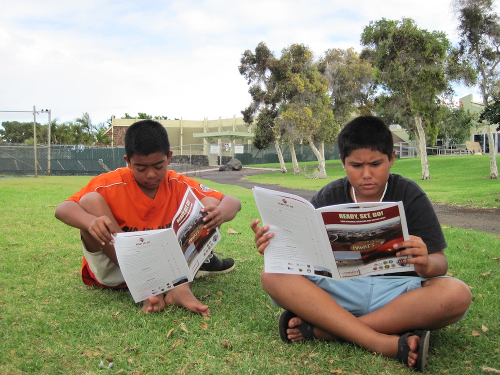 Students from Malama Kai Foundation's Ocean Warriors program read through Ready, Set, Go! Action Guides - part of an integrated approach to empower keiki to share what they've learned with their family and general public.