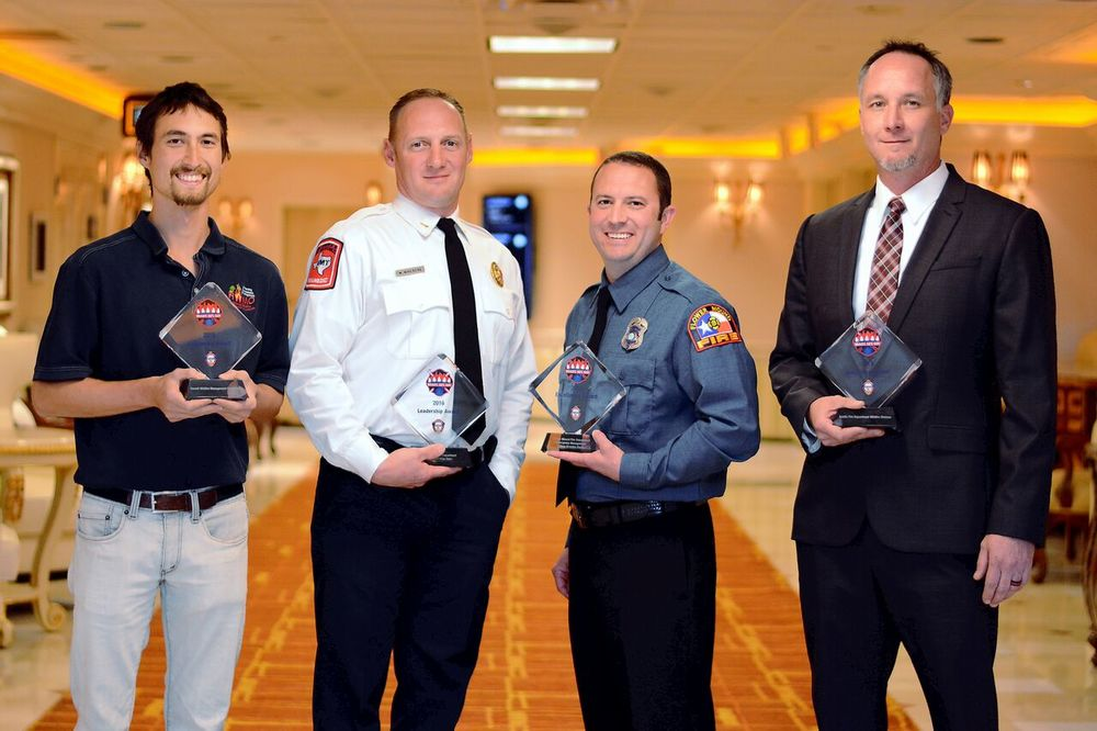 Pablo Beimler (left) representing HWMO poses with other winners of the RSG! Awards: Aubrey FD, Flower Mound FD, and Austin FD.