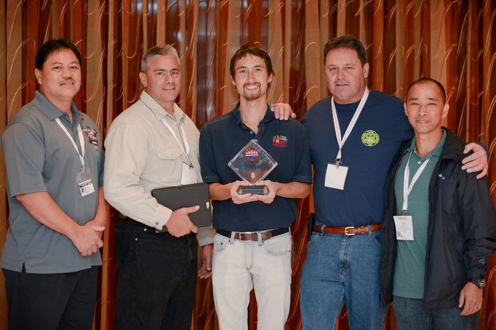 Pablo Beimler shares HWMO's Ready Set Go! Leadership Award with Hawaii FD's (from left to right) Chief Gantry Andrade, Chief Darren Rosario, Captain Bill Bergin, and BC Jerry Lum.