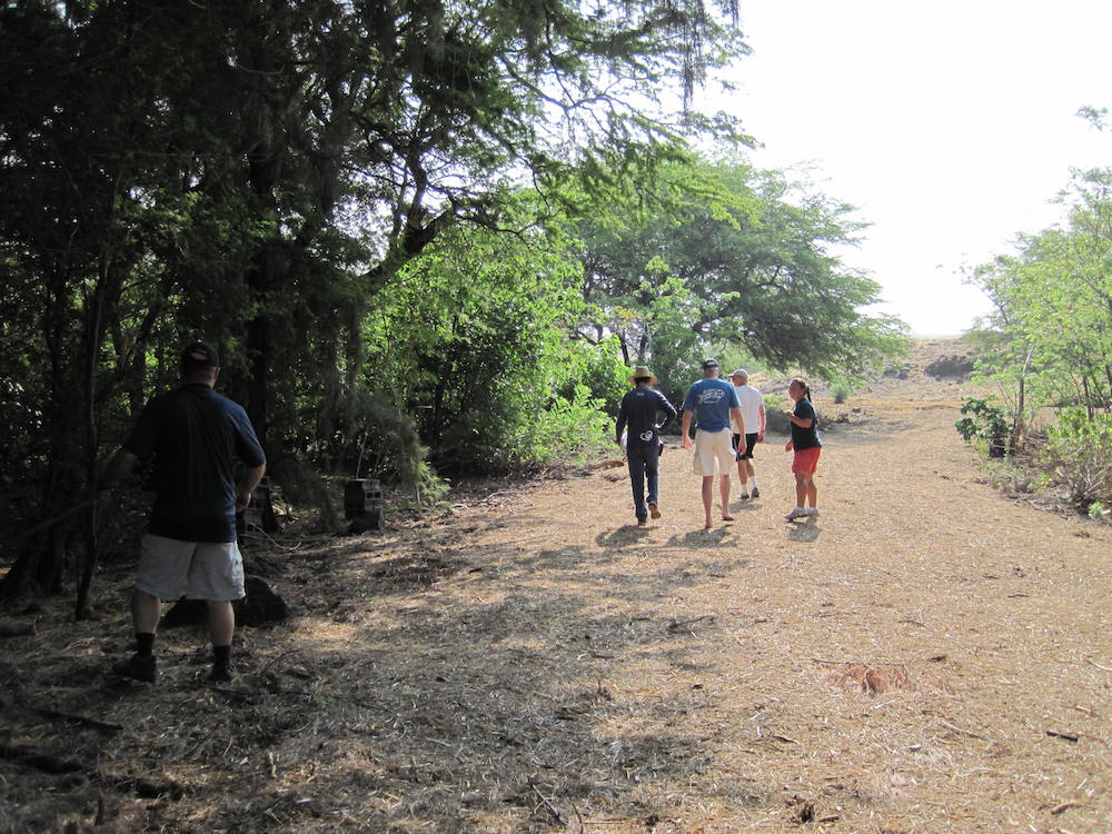 Waialea residents and homeowners walk along a fire access road that splits the living fuelbreak.