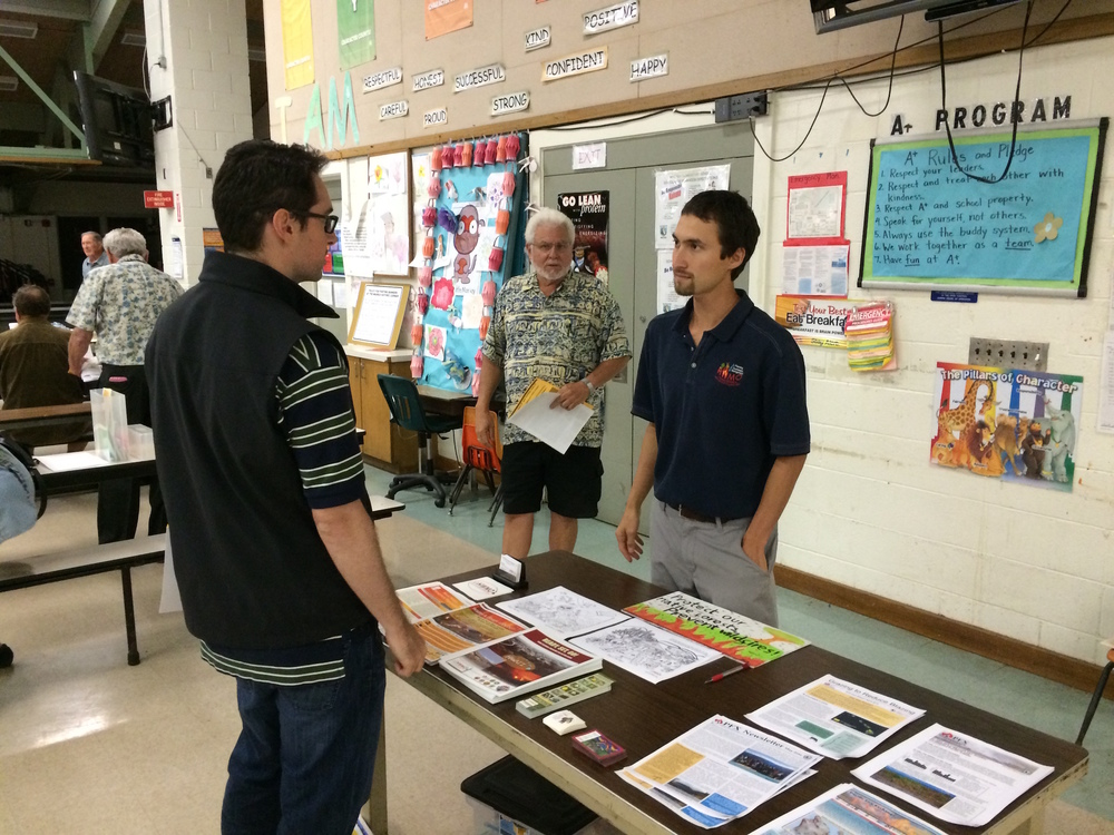 Pablo Beimler speaks with community member about wildfire preparedness.