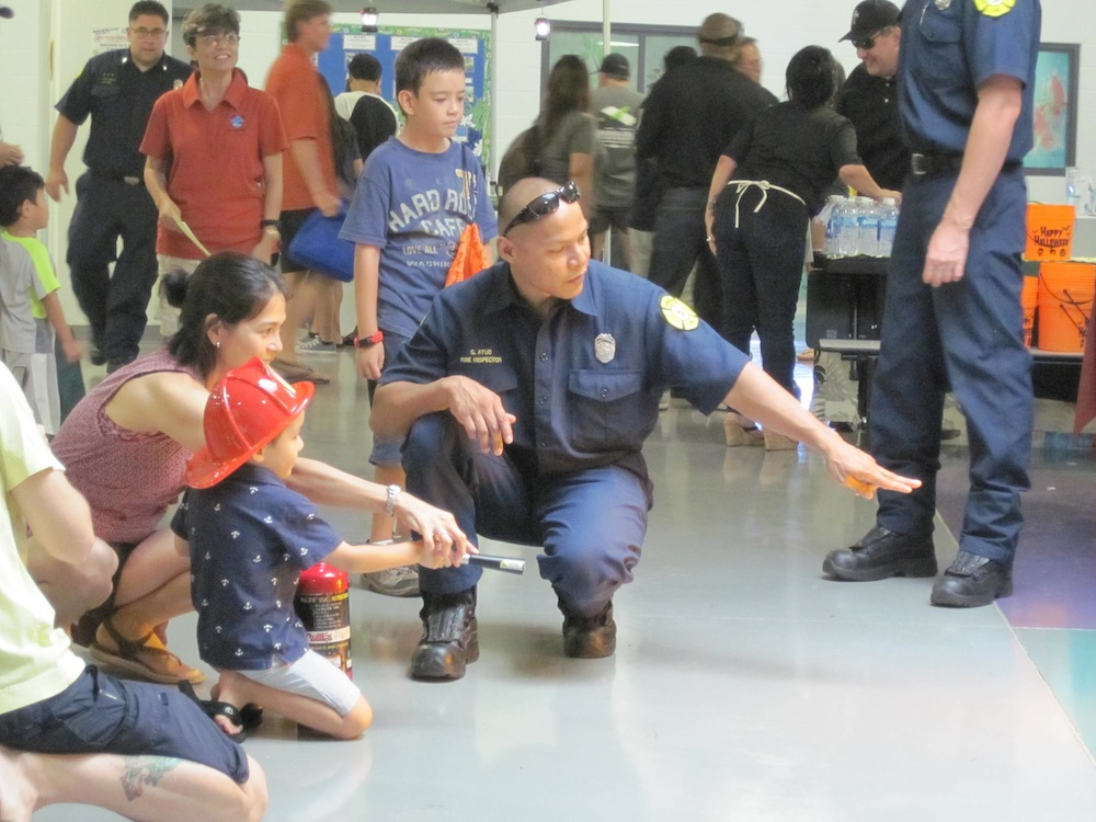 Honolulu Fire Department firefighters gave lessons on fire extinguisher use...for all ages.