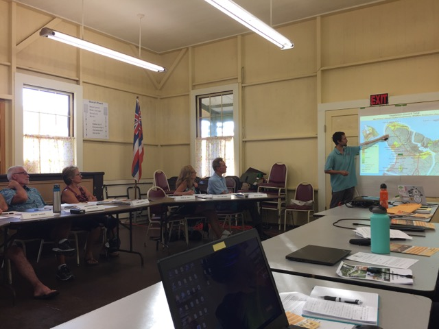 Pablo Beimler pointing to a map of wildfire hazards in Northwest Hawaiʻi Island during the CDP presentation. Credit - David Tarnas