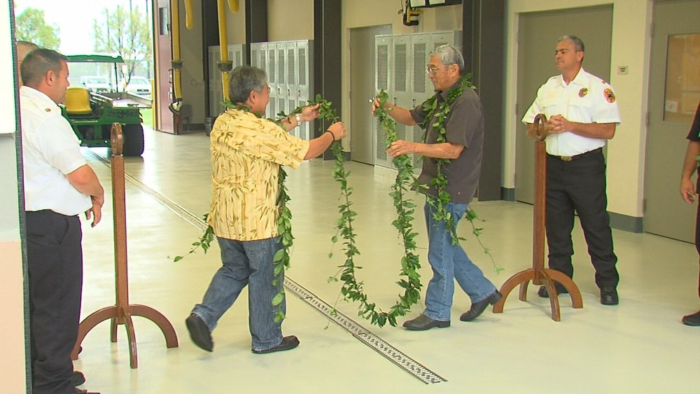 """Dennis Onishi and Harry Kim untie the maile lei."" Credit: Big Island Video News"