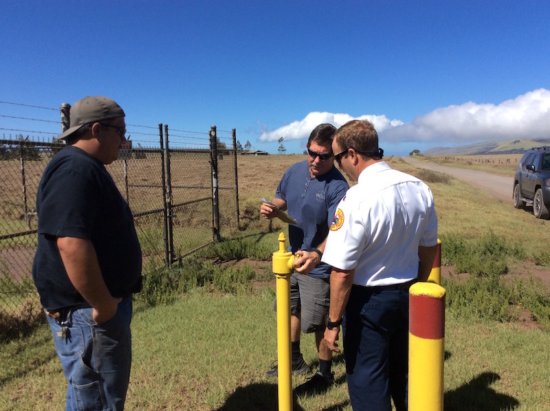 The assessment crew examining a standpipe in Puukapu.