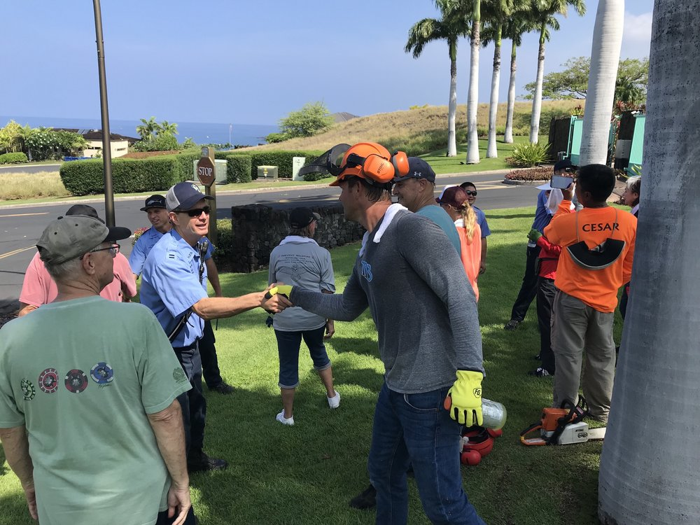 Firefighters from Hawaii Fire Department give encouragement and thanks to community members who were hard at work all morning for Community Wildfire Preparedness Day.