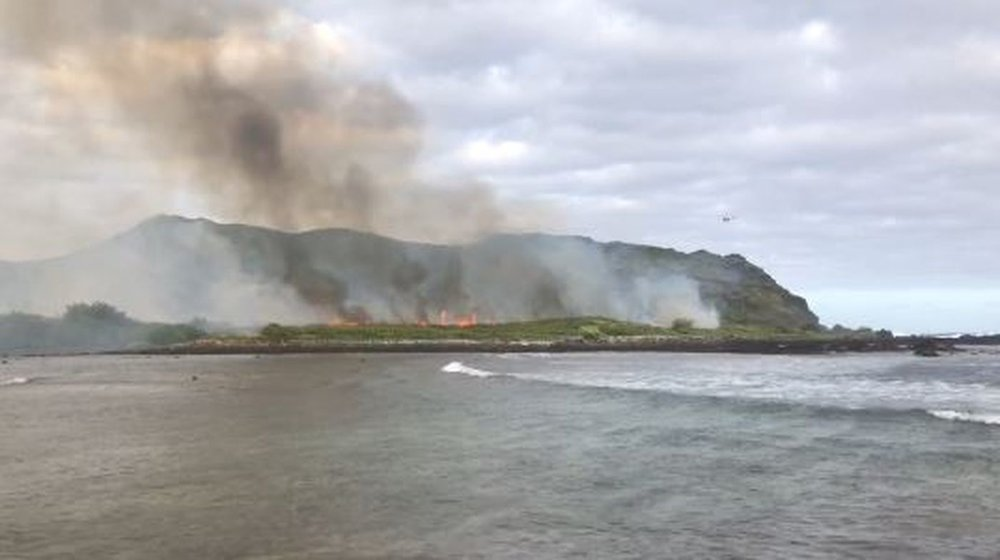 """Firefighters working to put out a brush fire on Oahu's east side."" Credit: Hawaii News Now"