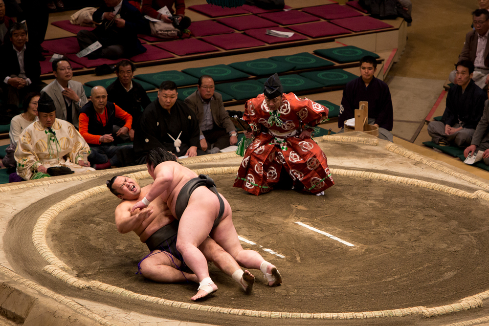 In one of the last of the preliminary bouts, the wrestler on the bottom injured his leg in this fall and was taken off in a novelty oversized wheelchair.