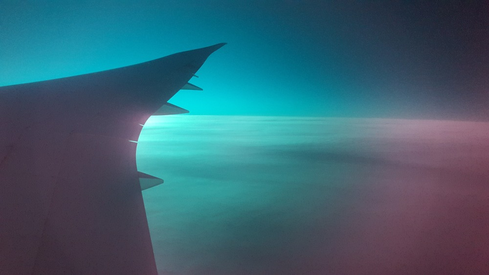 Crazy early morning light off the wing of our Boeing Dreamliner, somewhere over the Atlantic.