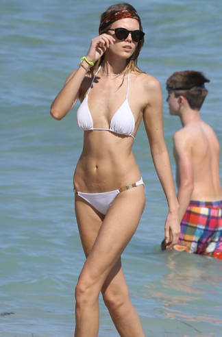 MARYNA LINCHUK  Model Maryna Linchuk chooses a white bikini on the beach in Miami.