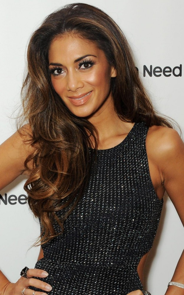 """Nicole Scherzinger """"I love Herbal Essences Moroccan My Shine shampoo and conditioner which keeps my hair shiny and smells amazing. It's gorge-wah magic in a bottle and after using, my hair is restored to touchable best!"""" Herbal Essences Moroccan My Shine Nourishing Shampoo & Conditioner, both £1.89 at Boots"""