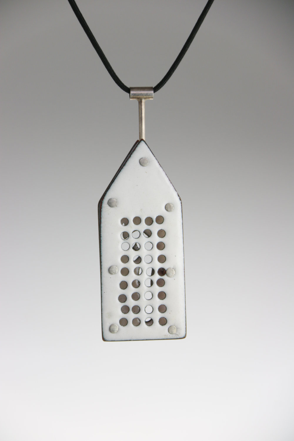 "sterling silver, enamel  2.5"" x 1"" x .35""  (side one)"