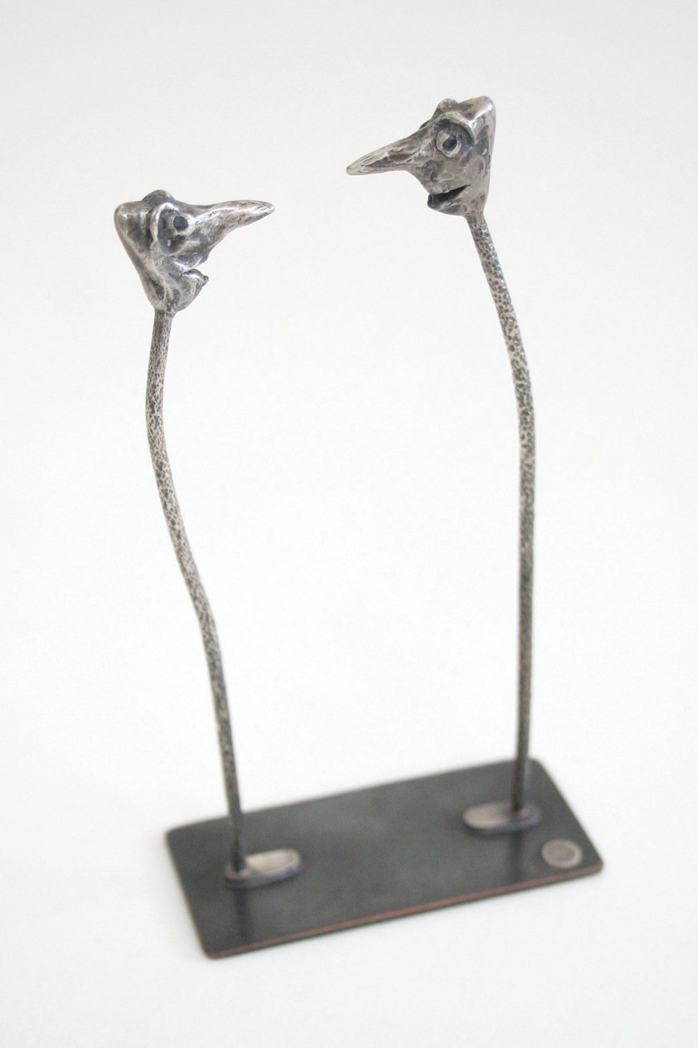 "sterling silver, bronze, black diamonds  5.5"" x 2.9"" x 1.4"""