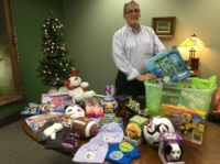 Boxing up items from the 2016 Schiffman Law Toy Drive.