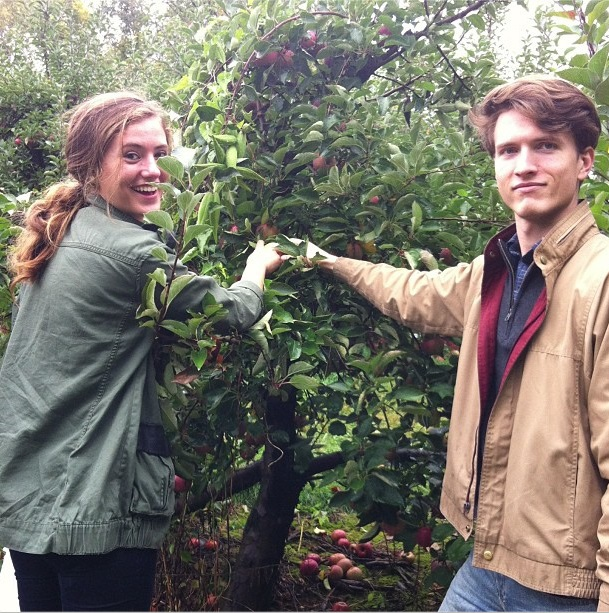 Brother and sister picking apples