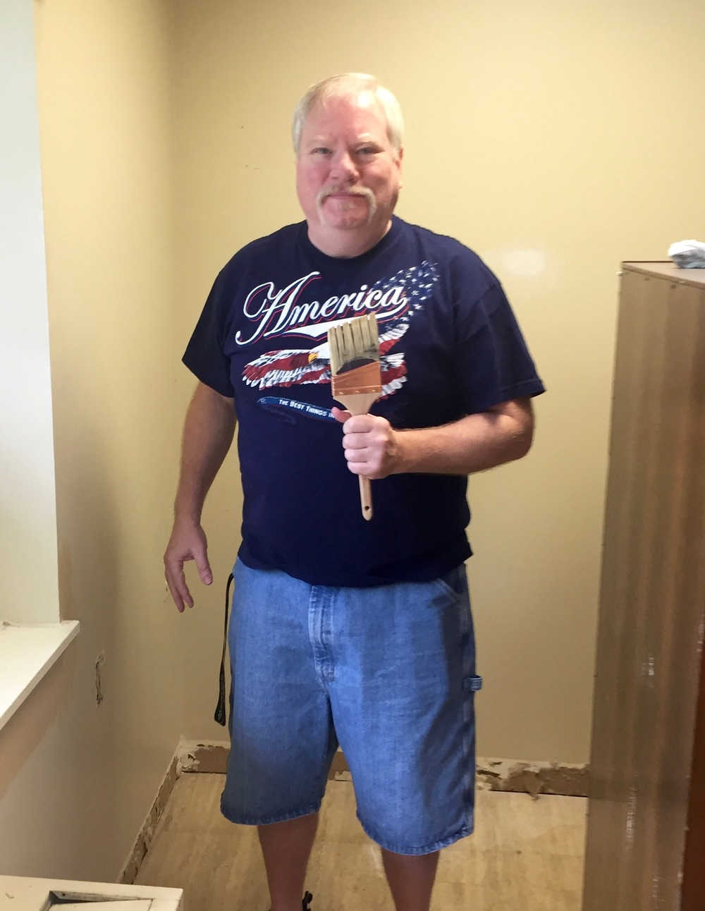 Jim, an ACC member, helps paint the Lockwood House library, a recent service project completed as a part of our partnership there.