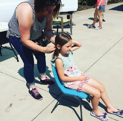 aos student savannah parker getting her hair styled behind the scenes of her bilo commercial shoot!