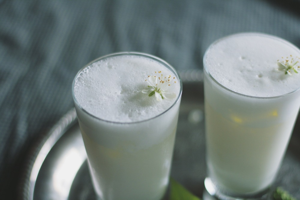 Ramos Gin Fizz garnished with plum blossoms