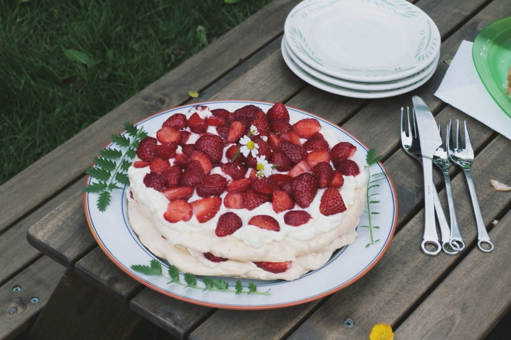 meringue cake with cream and strawberries