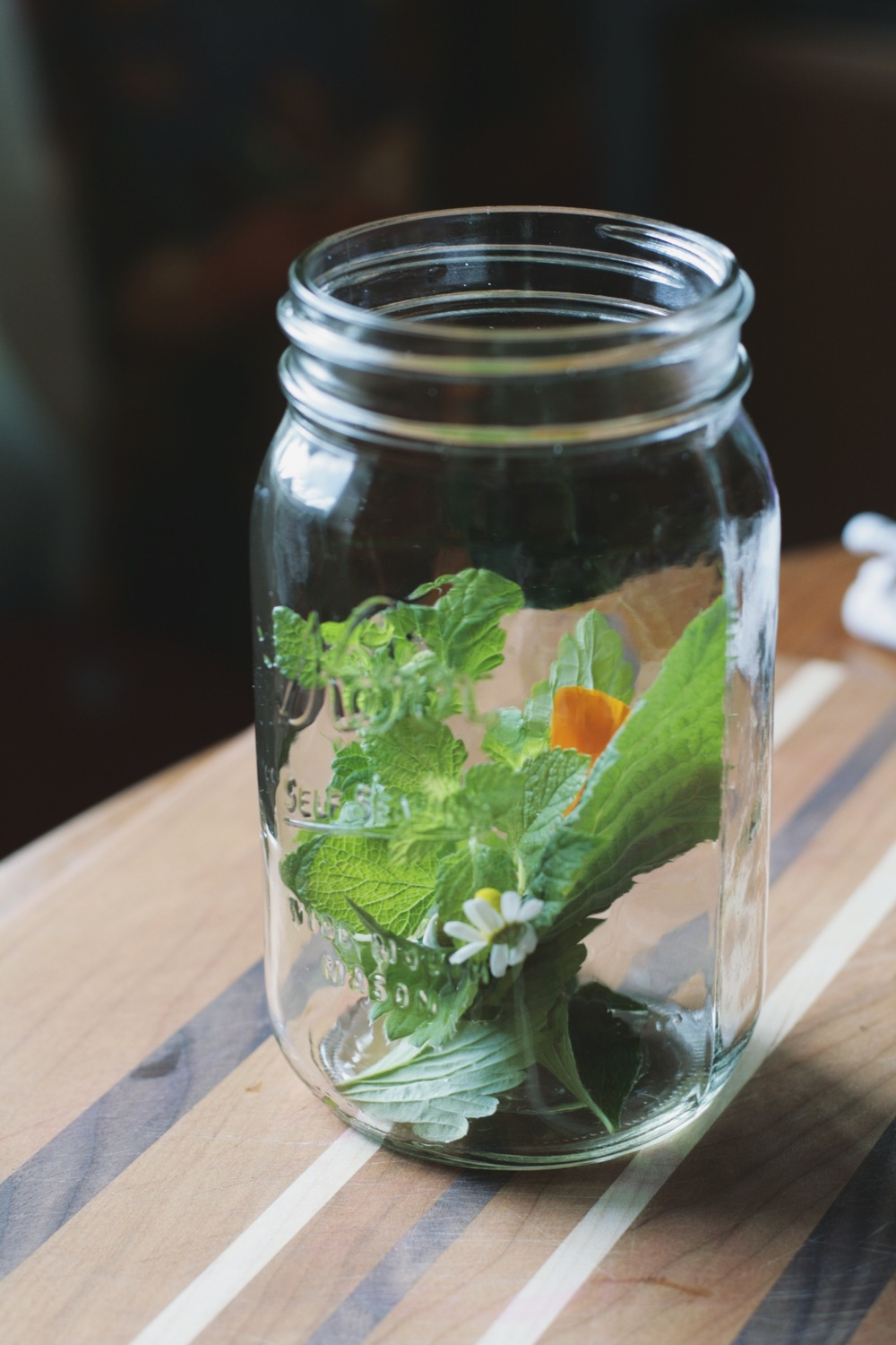I love to use mason jars for tisane - the herbs and flowers are visible and you can sip the brew from the jar