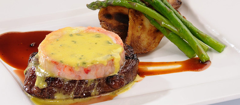 "We will be creating an upscale ""Steak and Lobster"" Dinner with Butter Poached whole Maine Lobster and Filet Mignon entrée. -"