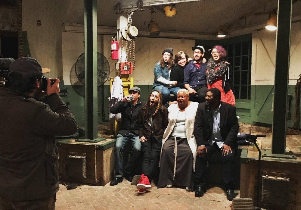 2017 Here Say artists after performance at Cherry Hollow Farm. Shira Erlichman, Cristin O'Keefe Aptowicz, Anis Mojgani, Eve Ewing, Derrick Brown, Bright Son, Dame Wilburn, and Ray Christian.