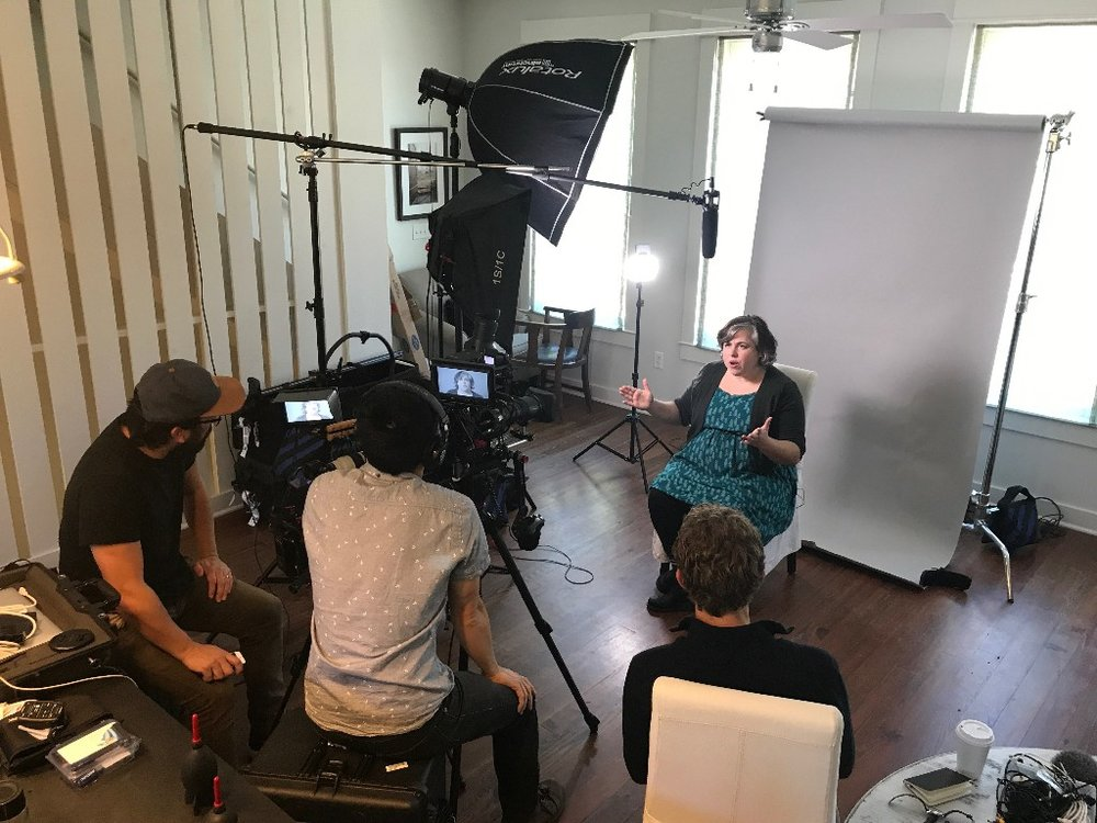 Cristin O'Keefe Aptowicz speaking on camera about the power of words in growing up. With Grady Powell of Openfields and filmmakers Jake and Isaac Gee.