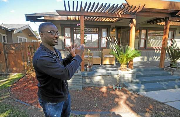 With four children now, Chad Clark is looking to sell his house in the Craftsman Village area of Long Beach and relocate nearby into a larger home. His house on 8th Street near Orange Ave. is on the market for $489,000. (Scott Varley / Staff Photographer)