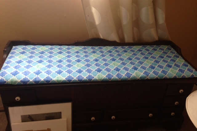 I reupholstered my mom's old Lane Cedar Chest. The old fabric needed a little refreshing.