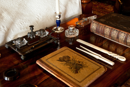 Items on the writing table in the Red Bedroom. ©National Trust Images/David Kirkham