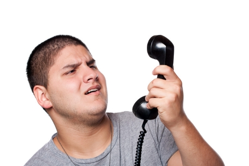 cutcaster-902449422-Man-Screaming-Into-the-Telephone-small.jpg