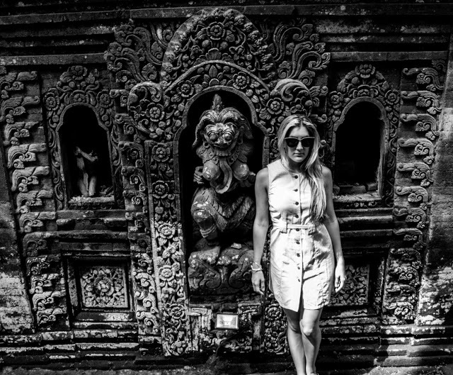 Posing in front of a wall at the Ubud Palace.