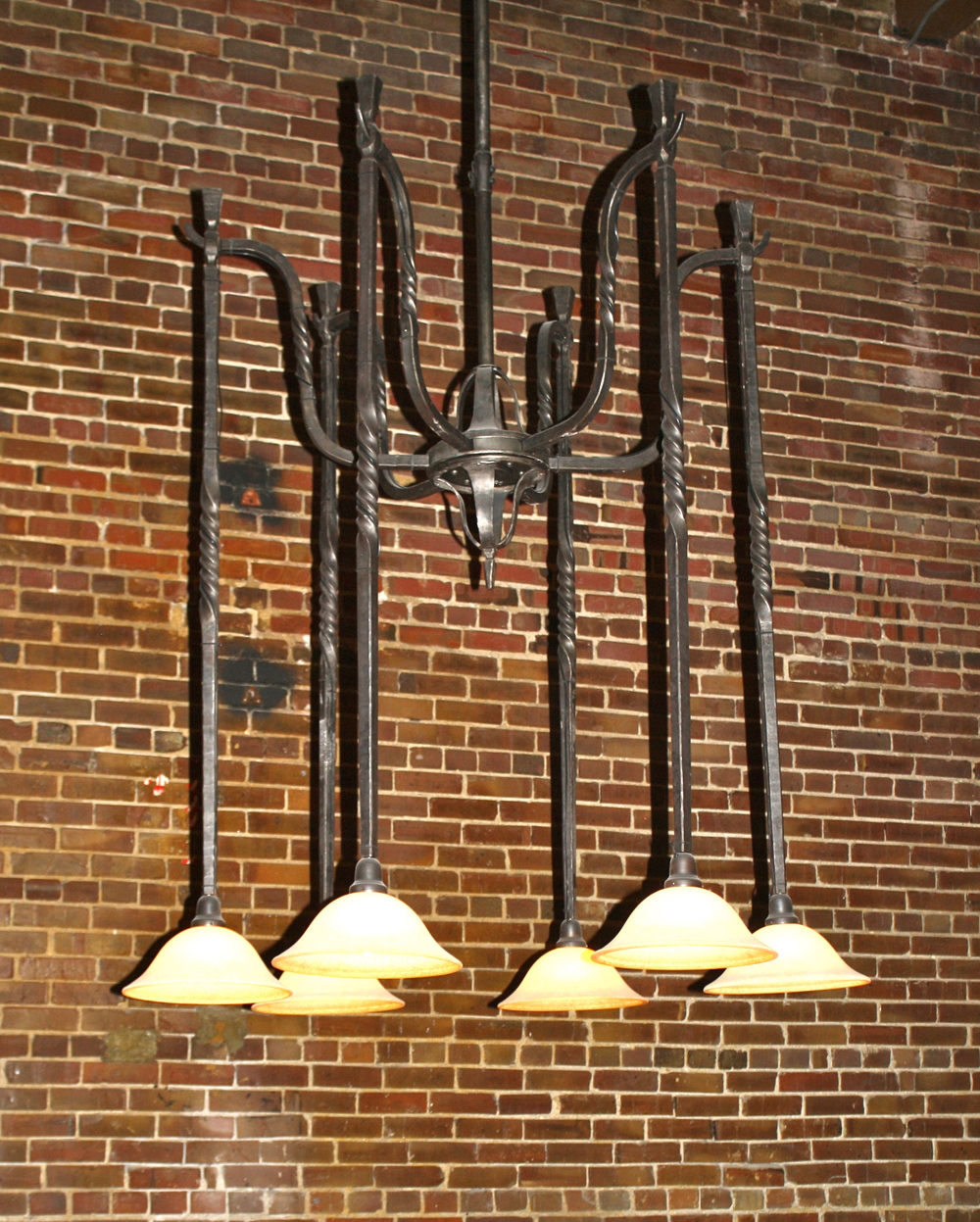Lighting fixture designed and forged by Robert Thomas at Artisans of the Anvil Inc.