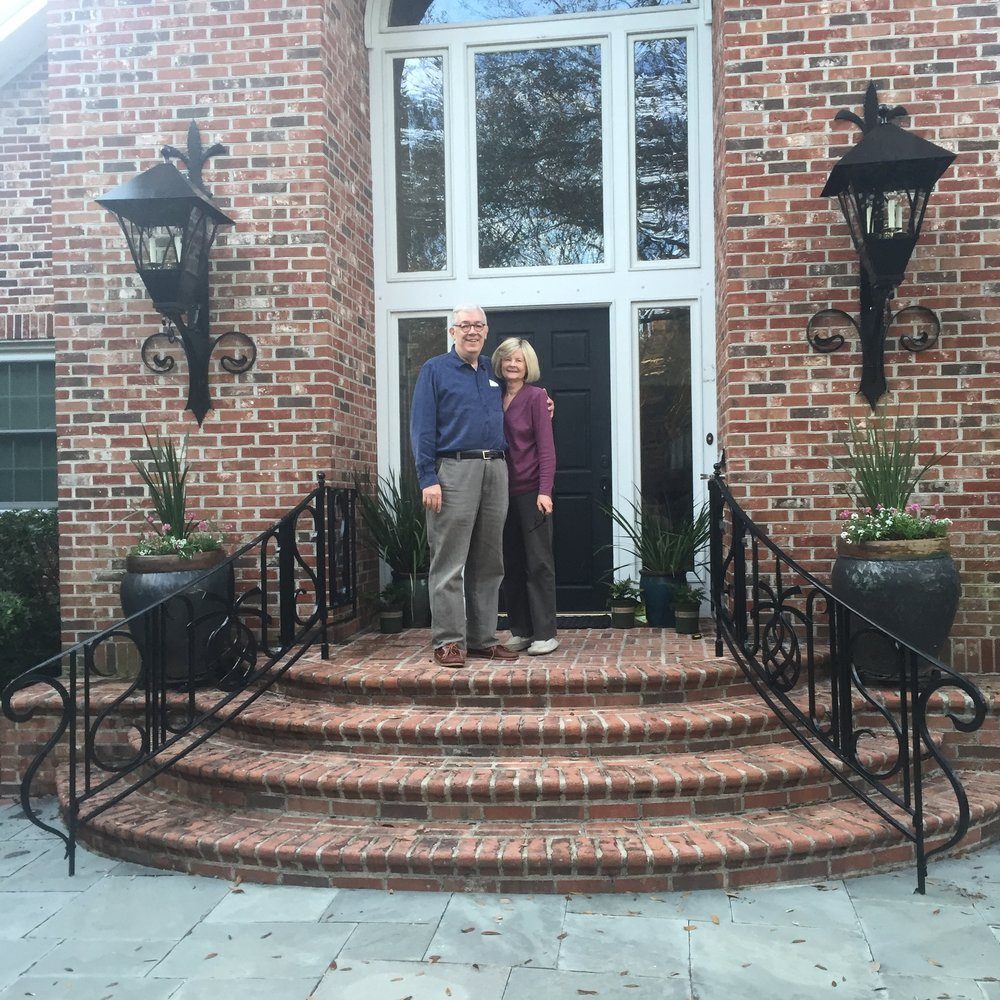 Curved entrance railings and matching lanterns