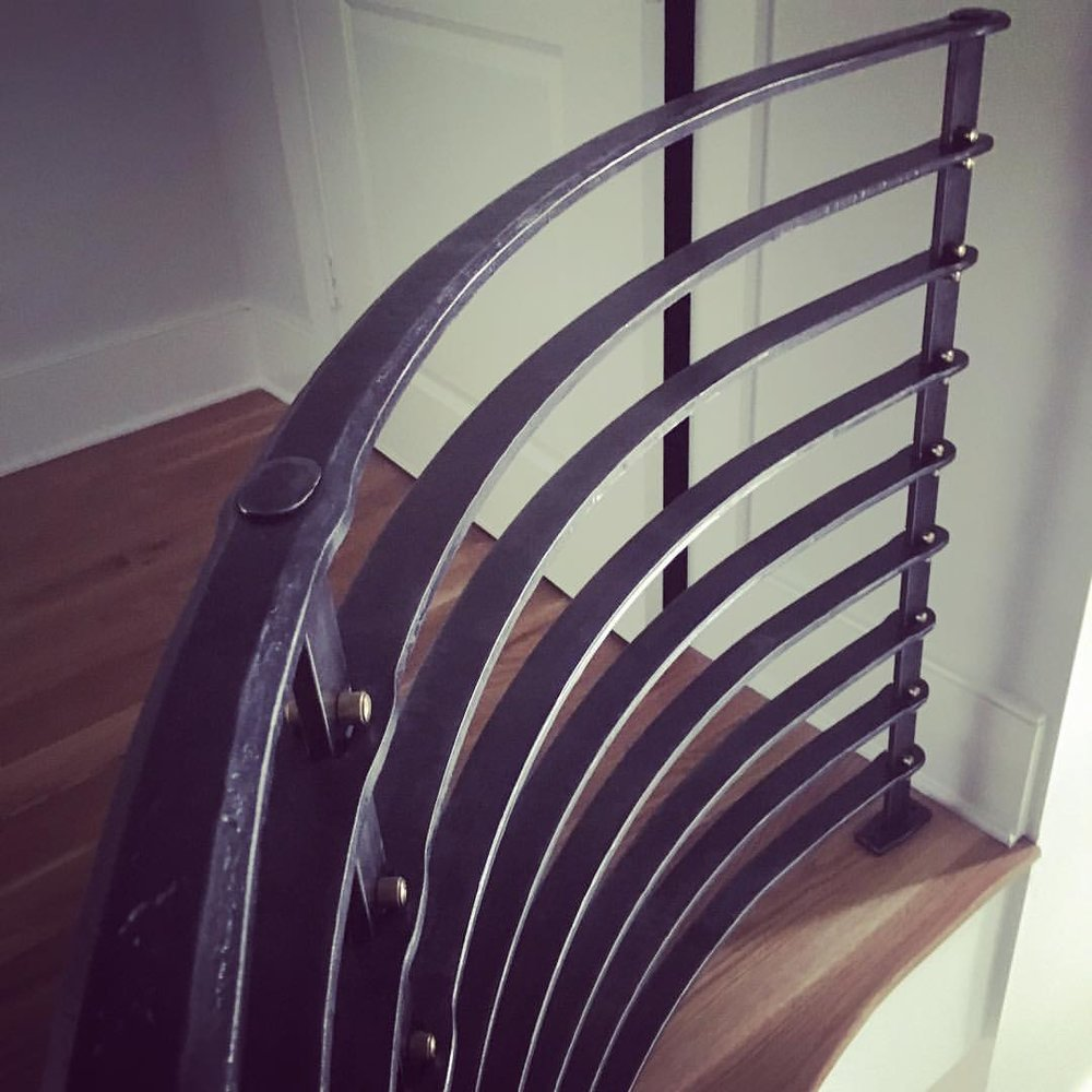 Balcony railing with traditional joinery and brass rivets