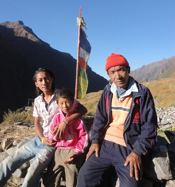 Jalman (middle) at home with his brother and Step Father in Langtang.