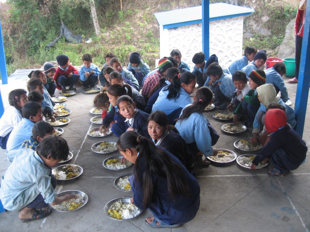 Community-Support-Gurje-Food-for-Education-group-eating-1024x768.jpg