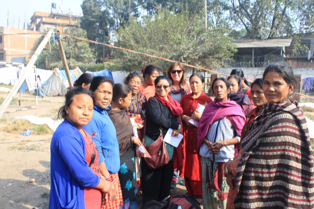 Group of women who have lost their homes who received Day's For Girls kits