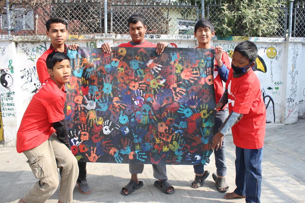 Umbrella boys with the painting from Gilgandra school