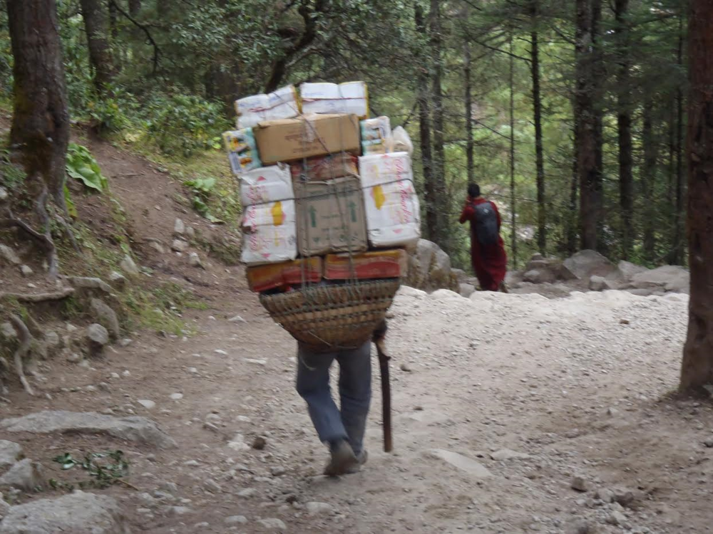 Locals carrying supplies