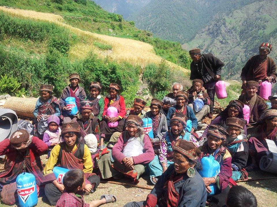 community members of Gatlang with sleeping bags