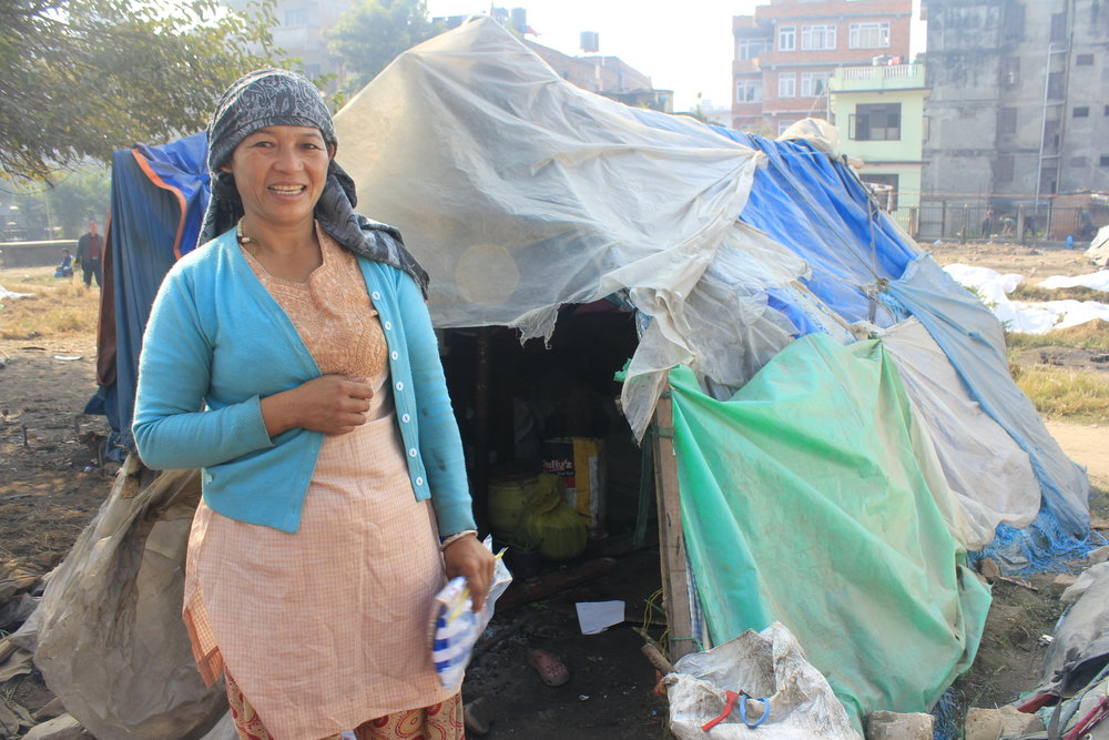 one of the ladies living with her child in a tent city.  Very happy to have recieved some assistance