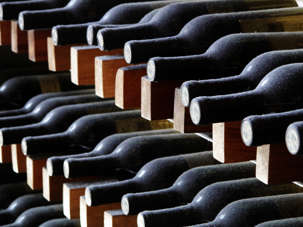 racks-of-wine-bottles-in-a-cellar.jpg