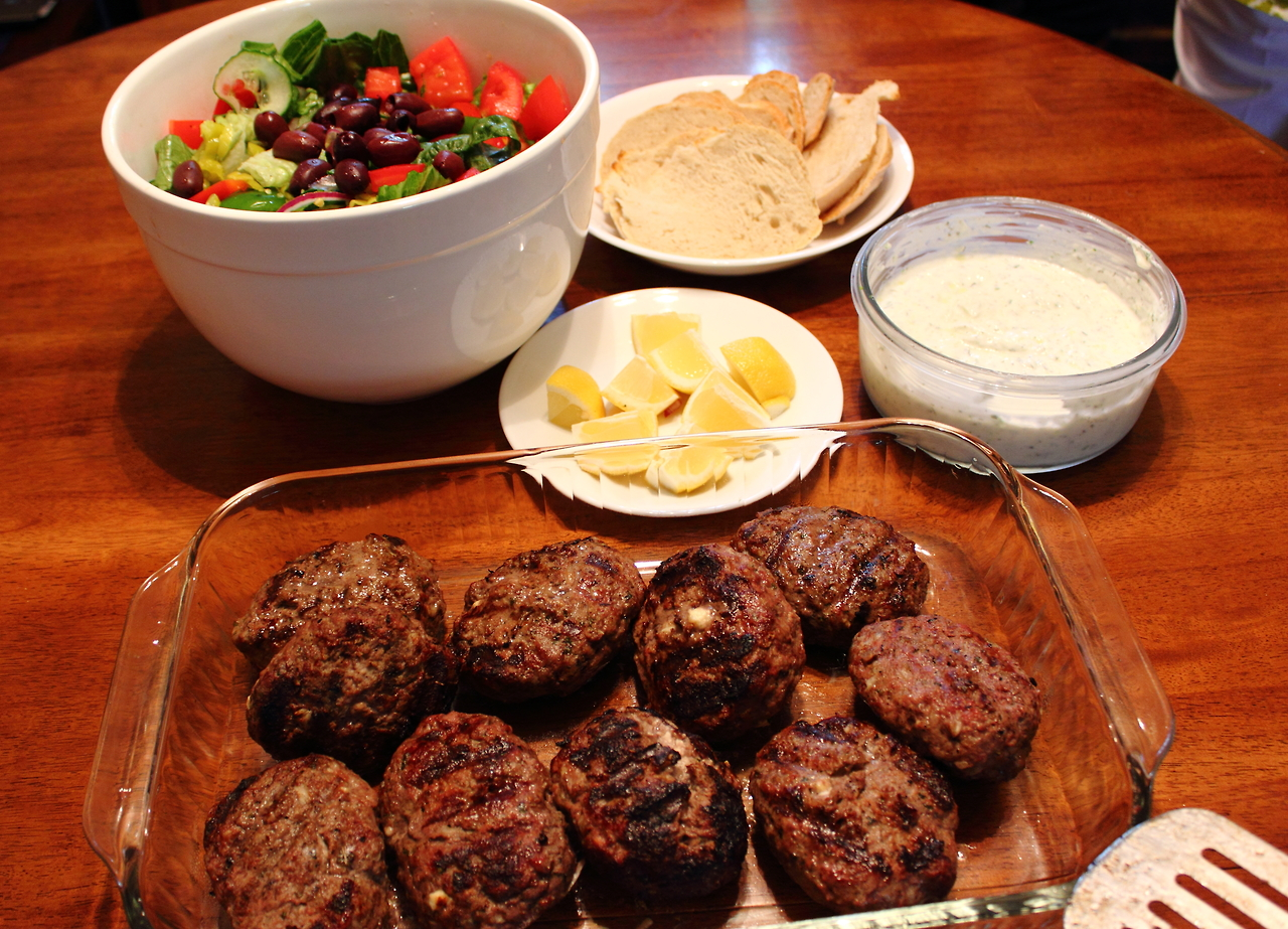 Mother's Day dinner for Shelby. I made her favorite: Beefteki (minted, ground lamb stuffed with feta), Greek salad, artisan bread, and tzatziki. Happy Mother's Day!    i<3food