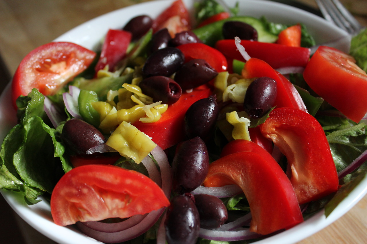 Greek Salad. Tomatoes, Kalamata olives, red and green bell peppers, red onion, and pepperoncinis.