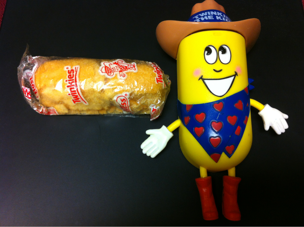 This is what a 13 year old Twinkie looks like. I've had this in the Twinkie sarcophagus bestowed upon me by former co-workers. The wrap is airtight still but a sickly sweet smell permeates through the thin plastic. The Twinkie is crumbling with age and feels petrified. I do not believe it is edible.