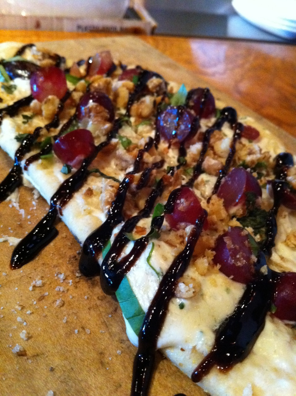 Sonoma Flatbread @ Fire & Vine, Virginia Beach, VA. Goat cheese mousse, red grapes, candied walnuts, balsamic syrup, fresh herbs, crispy wood-oven flatbread. This was very good. If you go during happy hour they are only $5! Definitely worth a visit.