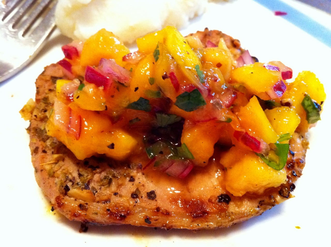 Grilled Cuban style pork with a Mango/Papaya Salsa. Recipe here: http://www.tasteofcuba.com/cubanporksalsa.html